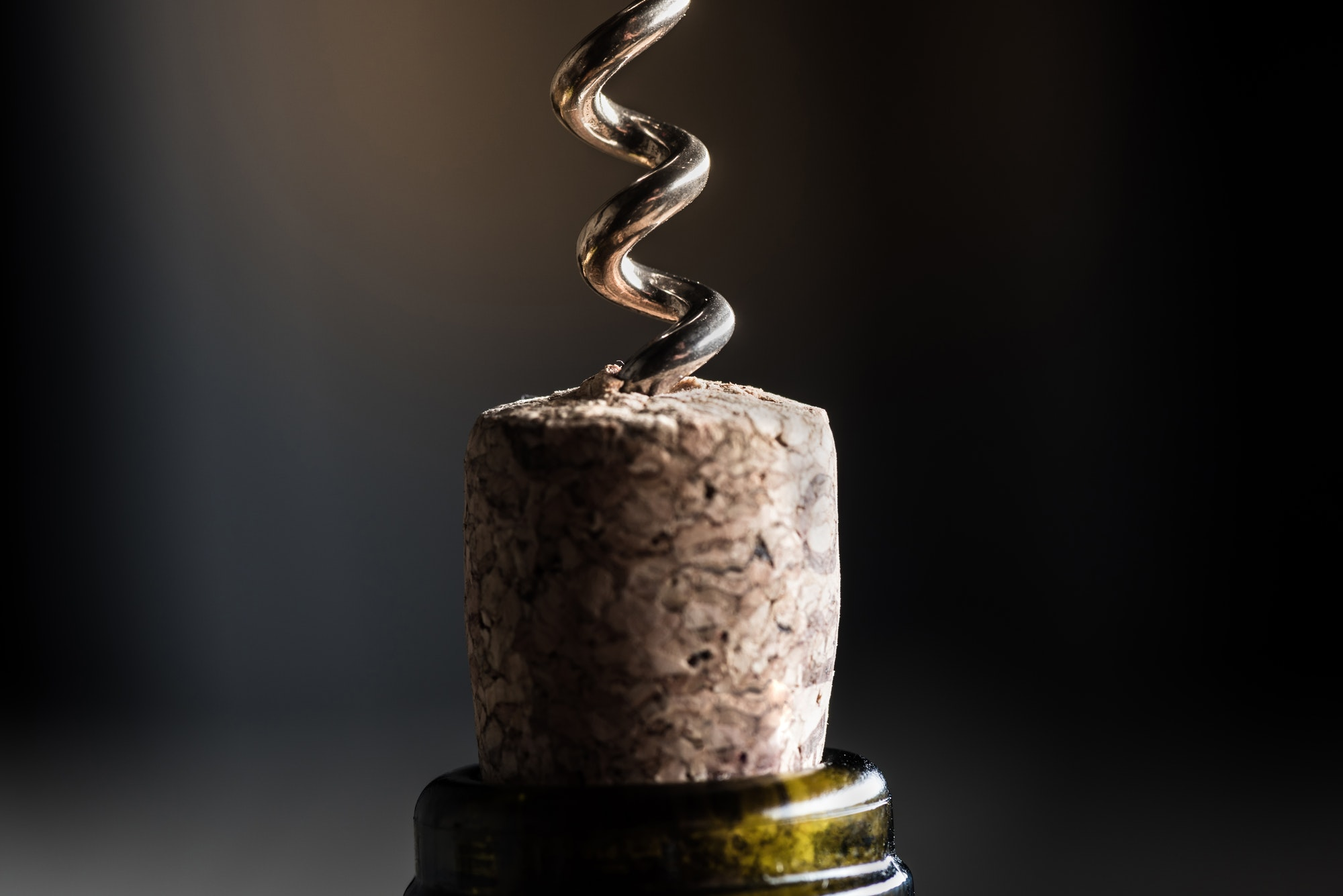 close up view of wine bottle with corkscrew with copy space